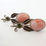 Angle skin vintage coral and cabochon peridots set in oxidized sterling silver. Thimbleberry earrings