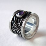 Purple star sapphire set in sterling silver. Tangled Garden ring