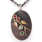 Rubies, opal, emerald, 18 karat gold and oxidized sterling silver