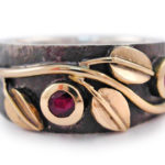 Rubies, 18 karat gold and oxidized sterling silver