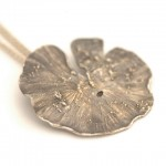 Fused gold on oxidized sterling silver. Lily pad pendant