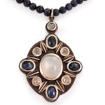 Moonstone cabochon, rose cut blue and white sapphires and oxidized sterling silver