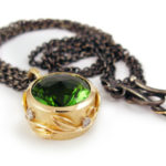 Green tourmaline and diamonds in 18 karat gold with oxidized sterling silver chain with gold accent