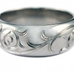 19 kt. white gold with hand engraved scroll work.