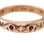 Rubies and diamonds set in 18 kt. gold with hand engraved scroll work